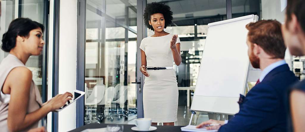 Businesswoman giving a presentation in a boardroom, meeting, conference, group, diverse, woman